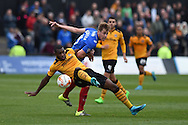 Lenell John-Lewis of Newport county is tackled by Adam Webster of Portsmouth. Skybet football league two match, Newport county v Portsmouth at Rodney Parade in Newport, South Wales  on Saturday 17th October 2015.<br /> pic by  Andrew Orchard, Andrew Orchard sports photography.