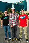 From left, Chad Kagy, pro BMX vert rider and X Games Gold Medalist, Travis Pastrana and Erik Roner of Nitro Circus pose for pics in front of The Signature at the MGM Grand Hotel & Casino on Wednesday June 1, 2011 in Las Vegas to promote the North American debut of Nitro Circus Live at the MGM Grand Garden Arena on Saturday June 4, 2011. (Jeff Bottari/AP Images for Nitro Circus Live)