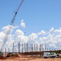 070815  Adron Gardner/Independent<br /> <br /> A crane dwarfs the support structure of a new elementary school under construction in Zuni Wednesday.