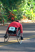 Man in wheelchair age 40 racing for finish line in Twin Cities Marathon.  St Paul  Minnesota USA
