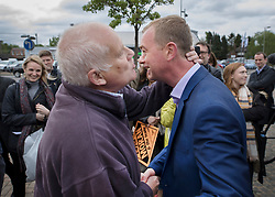 © Licensed to London News Pictures. 03/05/2017. Kidlington, UK. Liberal Democrat leader Tim Farron receives a kiss from local resident Malcom Baker (L) after Mr Baker argued with him during a campaign stop in Kidlington. Photo credit: Peter Macdiarmid/LNP