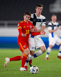 HELSINKI, FINLAND - Thursday, September 3, 2020: Wales' Harry Wilson (L) and Finland's Daniel O'Shaughnessy during the UEFA Nations League Group Stage League B Group 4 match between Finland and Wales at the Helsingin Olympiastadion. (Pic by Jussi Eskola/Propaganda)