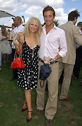 HANNAH SANDLING and OLIVER FELSTEAD at the Cartier International polo at Guards Polo Club, Windsor Great Park, on 30th July 2006.<br /><br />NON EXCLUSIVE - WORLD RIGHTS