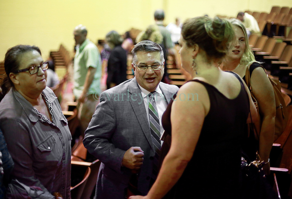 16 September 2014. New Orleans, Louisiana.<br /> Orleans Parish School Board meeting. CEO and Principal Keith Bartlett celebrates as Lycee Francais is approved to purchase the old blighted Priestley School to redevelop the building into a state of the art school. <br /> Photo Credit; Charlie Varley/varleypix.com
