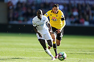Jose Holebas of Watford ® breaks away from Modou Barrow of Swansea city. Premier league match, Swansea city v Watford at the Liberty Stadium in Swansea, South Wales on Saturday 22nd October 2016.<br /> pic by  Andrew Orchard, Andrew Orchard sports photography.