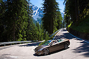 Volvo cabriolet sports car on The Stelvio Pass, Passo dello Stelvio, Stilfser Joch, route to Trafio in The Alps, Italy