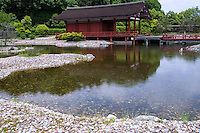 The ruin of Toin Garden constructed by Empress Shotoku in the 8th century was a place for receptions for court nobles.  The wooden structures are modern reproductions, although the garden stones and pond are original.  Toin Teien is a recent recreation of the original from the Nara period. The pond has an undulating topography of islands and coves which is spanned by both a flat bridge and a curved bridge. The pond also has an imitation beach made from pebbles and a model of houraisan - legendary island of immortals.
