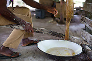 Macapa_AP, Brasil...Comunidade remascente de quilombolas do Curiau, em Macapa, Amapa. Na foto producao de farinha...The Quilombola remaining of Curiau, in Macapa, Amapa. In this photo a man is doing farinha (typical Brazilian food)..Foto: JOAO MARCOS ROSA / NITRO