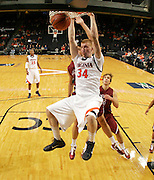 Nov 6, 2010; Charlottesville, VA, USA; Virginia Cavaliers James Johnson (34) dunks the ball Saturday afternoon in exhibition action at John Paul Jones Arena. The Virginia men's basketball team recorded an 82-50 victory over Roanoke College.