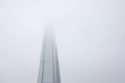The Shard appearing out of low cloud in London, United Kingdom. The Shard, also referred to as the Shard of Glass, Shard London Bridge and formerly London Bridge Tower, is an 87-storey skyscraper in London that forms part of the London Bridge Quarter development.