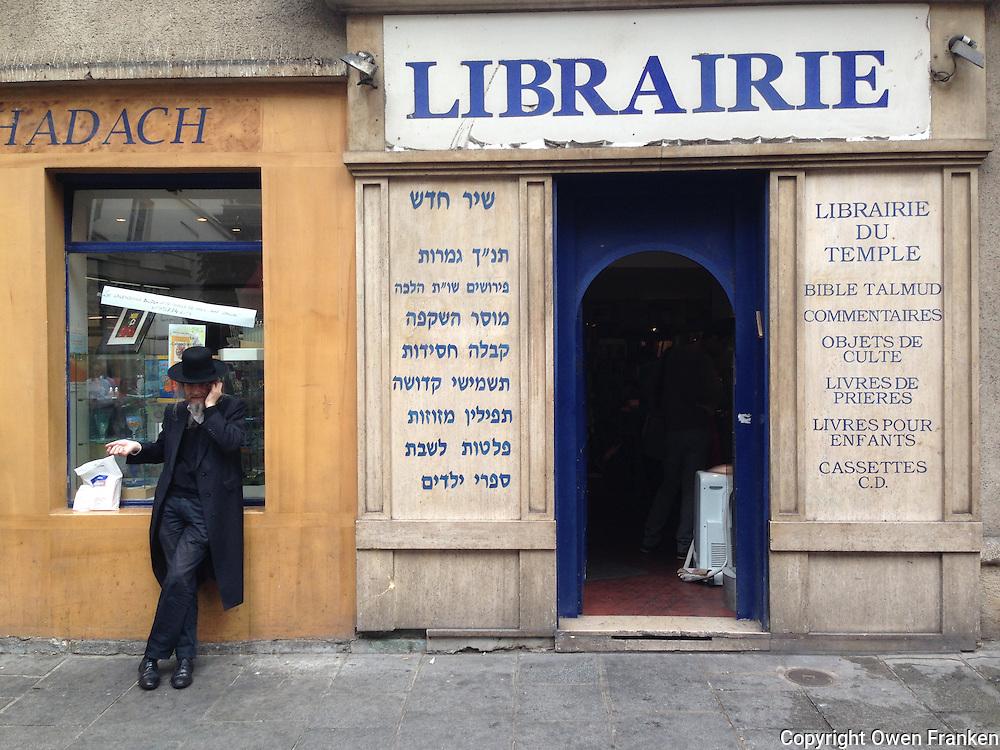 Hassidic Jewish man on the phone, in the Marais, a Jewish quarter in Paris
