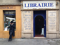 Hassidic Jewish man on the phone, in the Marais, a Jewish quarter in Paris