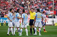 Referee shows a yellow card to Malaga´s Sanchez during 2014-15 La Liga match between Atletico de Madrid and Malaga at Vicente Calderon stadium in Madrid, Spain. November 22, 2014. (ALTERPHOTOS/Victor Blanco)