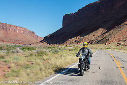 Denis Sharon riding his 1936 BMW r12 on the two-lane Utah Highway 128 along the Colorado River south toward Moab during stage 11 (289 miles) of the Motorcycle Cannonball Cross-Country Endurance Run, which on this day ran from Grand Junction, CO to Springville, UT., USA. Tuesday, September 16, 2014.  Photography ©2014 Michael Lichter.