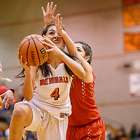 Gallup Bengal Journey Gilson (4) is fouled by the Espanola Sundevils as she drives to the hoop Tuesday at Gallup High School.