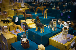 © London News Pictures. 07/03/2013. Birmingham, UK. Minature ornaments of dogs on a sales stand on day one of Crufts at the Birmingham NEC Arena on March, 07, 2013 in Birmingham, England.  Crufts, which is the largest annual dog show in the world, hosts over 20,000 dogs and owners who compete in a variety of categories. Photo credit : Ben Cawthra/LNP