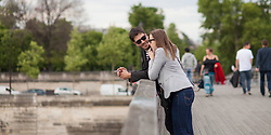 Young French couple on La Saine river, Paris, France. 09/05/14. Photo by Andrew Tallon