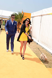 PERCY PARKER and AMY MOLYNEAUX at the Veuve Clicquot Gold Cup, Cowdray Park, Midhurst, West Sussex on 21st July 2013.