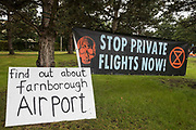 A banner and sign are displayed by Extinction Rebellion climate activists outside an entrance to Farnborough Airport on 2nd October 2021 in Farnborough, United Kingdom. Activists blocked three entrances to the private airport to highlight elevated carbon dioxide levels produced by super-rich passengers using private jets and greenwashing by the airport in announcing a switch to sustainable aviation fuel SAF.