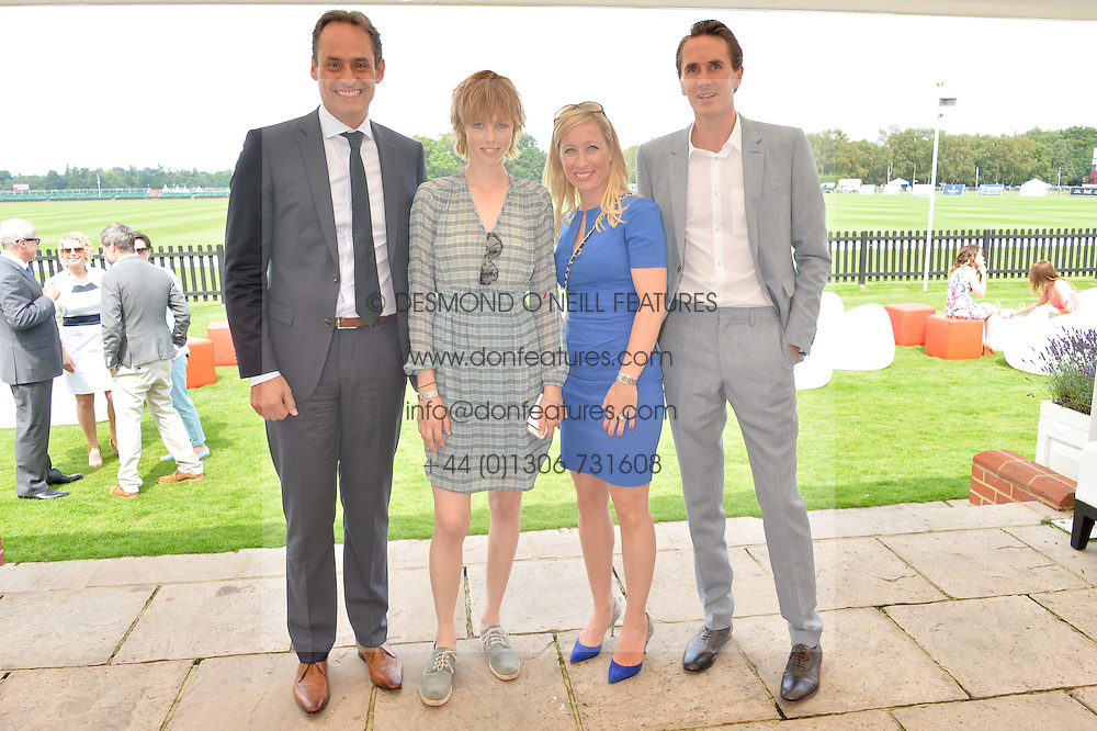 Left to right, ANDRE KONSBRUCK Director of Audi UK, EDIE CAMPBELL, CHRISTINE SIEG and OTIS FERRY at the Audi International Polo at Guards Polo Club, Windsor Great Park, Egham, Surrey on 26th July 2014.