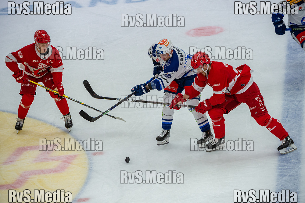 LAUSANNE, SWITZERLAND - OCTOBER 01: Sven Andrighetto #10 of ZSC Lions battles for the puck with Christoph Bertschy #22 of Lausanne HC during the Swiss National League game between Lausanne HC and ZSC Lions at Vaudoise Arena on October 1, 2021 in Lausanne, Switzerland. (Photo by Robert Hradil/RvS.Media)
