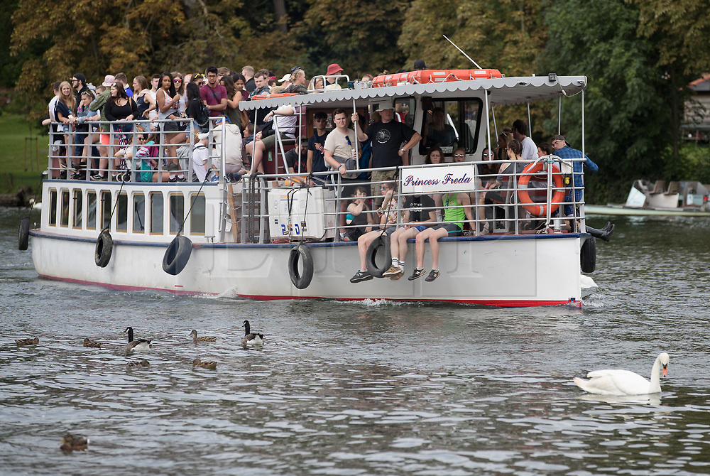 © Licensed to London News Pictures. 24/08/2017. Reading, UK. Music fans make their to Reading Festival by boat along the river Thames. The weather is expected to stay fine for the start of the three day music festival. Photo credit: Peter Macdiarmid/LNP