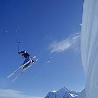 Kurt Denadell jumps big cornice at Mt. Baker ski area, WA, Mt. Shuksan bkg.
