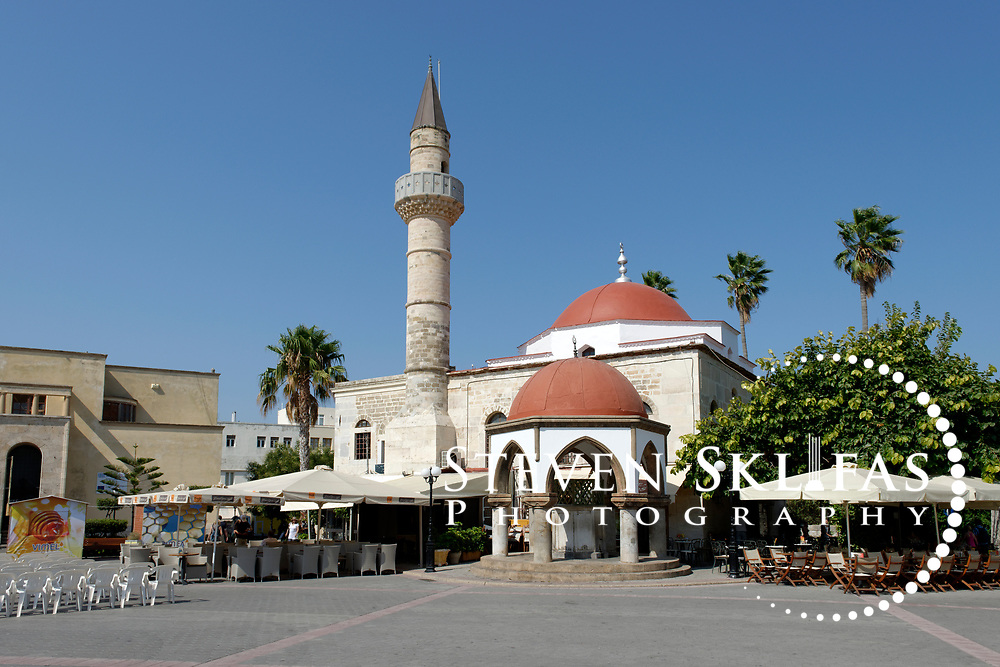 The Nefterdar (Defterdar) Mosque at Eleftherias Square in Kos town the capital of the Greek island of Kos. The Mosque dates back to 1786 and now  house a few small shops and a café. Kos is part of the Dodecanese island group and birthplace of the ancient physician and father of medicine, Hippocrates.