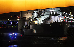 "A police boat passes under London Bridge by HMS Belfast as police have confirmed that incidents at London Bridge and Borough Market are ""terrorist incidents"", following reports of a vehicle ploughing into pedestrians on a bridge and stabbings."
