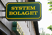 Sign for Systembolaget, the Swedish monopoly retail alcohol shops. Monopoly wine and spirits shop. Eksjo town. Smaland region. Sweden, Europe.