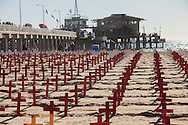 Arlington West memorial to fallen US soldiers since 9/11. The memorial is located on Santa monica Beach and is erected every Sunday morning till sunset. The red crosses denote 10 soldier deaths, the white ones denote one.
