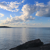 """""""On the Edge"""" <br /> <br /> Stand on the edge of jagged rocks on the shores of Lake Superior on Presque Isle Park in Marquette, Michigan! Enjoy still waters, blue skies and wonderful puffy white clouds!"""
