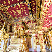 The ornate gold and red interior of Haw Pha Bang (or Palace Chapel) at the Royal Palace Museum in Luang Prabang, Laos. The chapel sits at the northeastern corner of the grounds. Construction started in 1963.