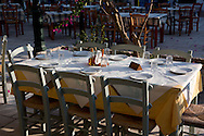 A taverna table in Lakka on Paxos, The Ionian Islands, The Greek Islands, Greece, Europe
