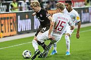 Fussball: 2. Bundesliga, FC St. Pauli - Holstein Kiel 2:1, Hamburg, 26.08.2019<br /> Mats Moeller-Daehli (Pauli, l.) - Johannes van den Bergh (Kiel)<br /> © Torsten Helmke