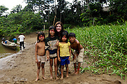 Ecuador, May 9 2010: Liane Norman poses with children from one of the Huaorani communities. Copyright 2010 Peter Horrell
