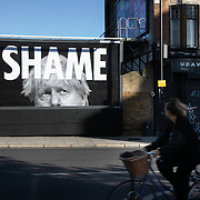 A billbord poster with an image of Prime Minister Boris Johnson and the word SHAME November 4th 2020 in Hackney, London, United Kingdom. The artwork is by the artist Subvertiser.