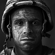 "U.S. Marine Gysgt. Carlos ""OJ"" Orjuela age 31who is part of Alpha Company of the 24th Marine Expeditionary Unit (MEU) Battle Landing Team (BLT) 1/6, after riding in a convoy in Garmsir District, Helmand Province, Afghanistan at Forward Operating Base Apache North. Located in Southern Helmand Province, Garmsir has been a haven for insurgents for the last several years. Earlier this year the Marines cleared the area after a period of heavy fighting. Carlos is from New Jersey and has done one tour in Iraq in addition to this tour."