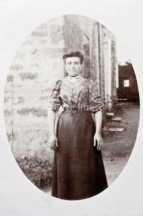 portrait of adult woman standing outside early 1900s