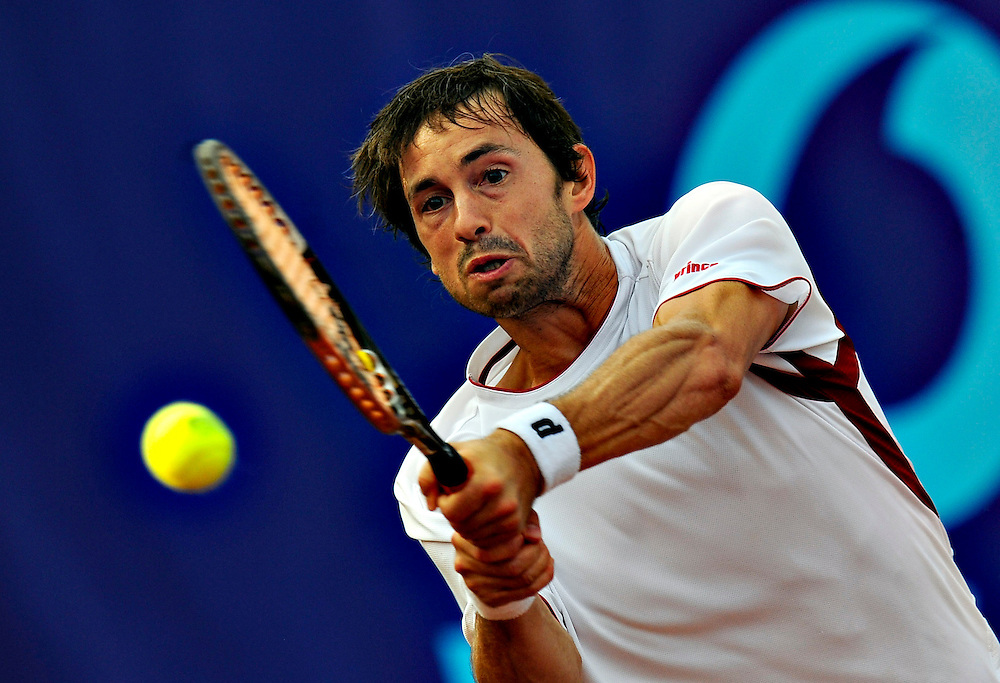 Italy's Fabio Fignini returns a ball, in the quarter final mactch of BCR Open Romania, against Spain's Albert Montanes.