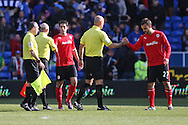 Cardiff city players Peter Whittingham and Juan Cala shake hands with match officials Mike Mullarkey and referee Howard Webb at the end of the match. Barclays Premier league match, Cardiff city  v Stoke city at the Cardiff city stadium in Cardiff, South Wales on Saturday 19th April 2014. pic by Mark Hawkins, Andrew Orchard sports photography,