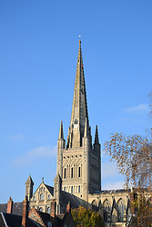 Maintenance workers scale Norwich Cathedral's spire, UK November 2020