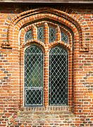 Historic village parish church at Kenton, Suffolk, England, UK red brick Tudor window architectural detail