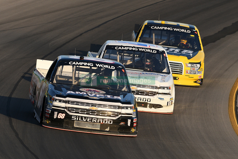 July 12, 2018 - Sparta, KY, U.S. - SPARTA, KY - JULY 12: Clay Greenfield (68) Chevrolet Silverado keeps Wendell Chavous (49) SobrietyNation.org Chevrolet Silverado and Grant Enfinger (98) Curb Racing Ford F-150 being his as the group of trucks work their way off of turn four during the NASCAR Camping World Truck Series Buckle Up In Your Truck 225 on July 12th, 2018, at Kentucky Speedway in Sparta, Kentucky. (Photo by Michael Allio/Icon Sportswire) (Credit Image: © Michael Allio/Icon SMI via ZUMA Press)