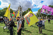 Turkish Kurds in Britain carry a portrait of Kurdistan Worker's Party (PKK) leader Abdullah Ocalan in central London as they demonstrate against Turkey's offensive on PKK areas in northern Iraq on Wednesday, Aug 18, 2021. (VX Photo/ Vudi Xhymshiti)