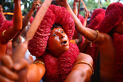 April 13, 2018 - Dhaka, Bangladesh - Hindu devotees dance as they take part in a festival called Lal Kach (Red Glass) during the last day of the Bangla month in Munshigonj, Dhaka. The Hindu youth and men paint themselves with red color and attend a procession holding swords as they show power against evil and welcome the Bengali New Year 1425 on April 14, 2018. (Credit Image: © Mushfiqul Alam/NurPhoto via ZUMA Press)