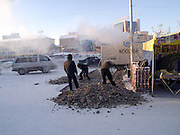 Workers are opening the deeply frozen street wih a pneumatic hammer during temperatures around -30 degrees Celsius in the city center of Yakutsk. Yakutsk is a city in the Russian Far East, located about 4 degrees (450 km) below the Arctic Circle. It is the capital of the Sakha (Yakutia) Republic (formerly the Yakut Autonomous Soviet Socialist Republic), Russia and a major port on the Lena River. Yakutsk is one of the coldest cities on earth, with winter temperatures averaging -40.9 degrees Celsius.