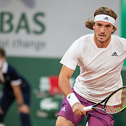 PARIS, FRANCE May 30.  Stefanos Tsitsipas of Greece in action against Jeremy Chardy of France in the first round of the Men's Singles competition on Court Philippe-Chatrier at the 2021 French Open Tennis Tournament at Roland Garros on May 30th 2021 in Paris, France. (Photo by Tim Clayton/Corbis via Getty Images)