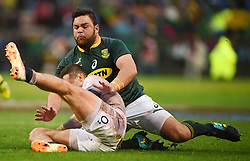 Cape Town-180623- Springbok player Frans Malherbe tackles England player  in the last game of the Castle Lager Test between Springboks and England at Newlands Stadium photographer:Phando Jikelo/African News Agency/ANA