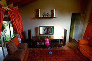 Billy and Moyahabo's younger doughter, Tlhase (3 years old), watch the tv in one of the 2 living room of the house.